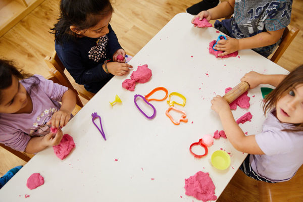 kids-playing-with-playdough-on-table