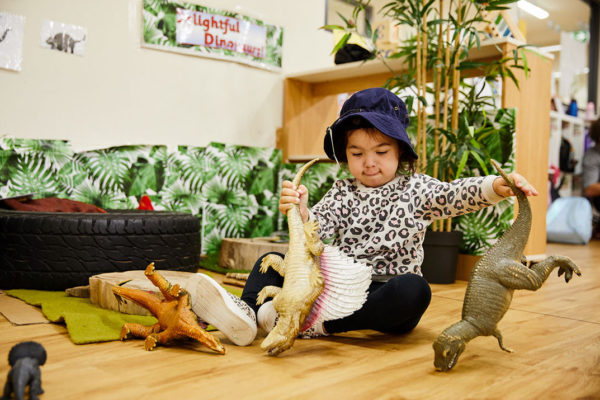 little-girl-playing-with-dinosaurs